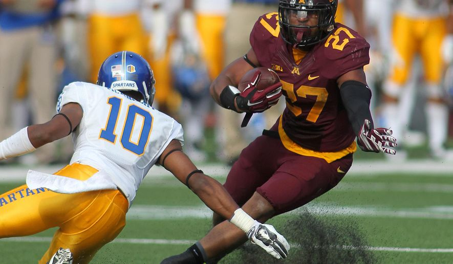 Minnesota running back David Cobb (27) cuts against San Jose State cornerback Maurice McKnight (10) in the first quarter during an NCAA college football game on Saturday, Sept. 20, 2014, in Minneapolis. (AP Photo/Andy Clayton-King)
