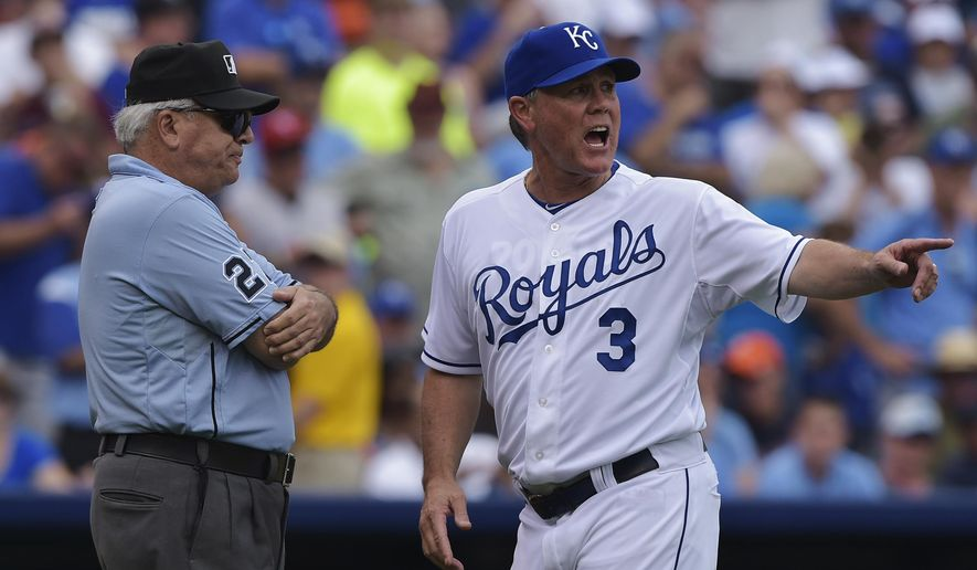 Kansas City Royals manager Ned Yost (3) argues a call with umpire Dan Bellino (2) that cost the Royals a run during the sixth inning of a baseball game against the Detroit Tigers, Saturday, Sept. 20, 2014, in Kansas City, Mo. (AP Photo/Reed Hoffmann)