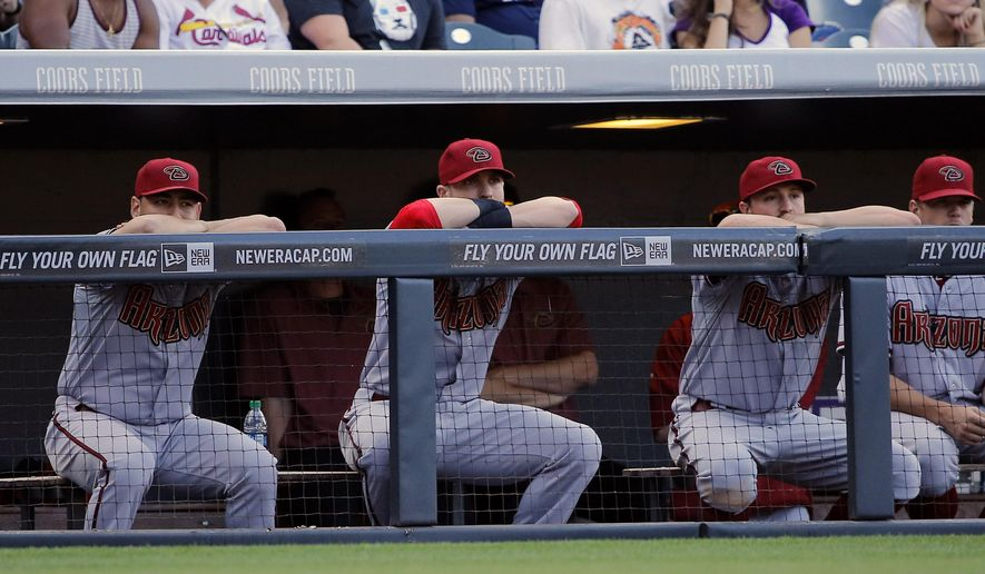 Members of the Arizona Diamondbacks watch during the ninth inning of a baseball game against the Colorado Rockies, Saturday, Sept. 20, 2014, in Denver. The Rockies beat the Diamondbacks 5-1.  (AP Photo/Jack Dempsey)