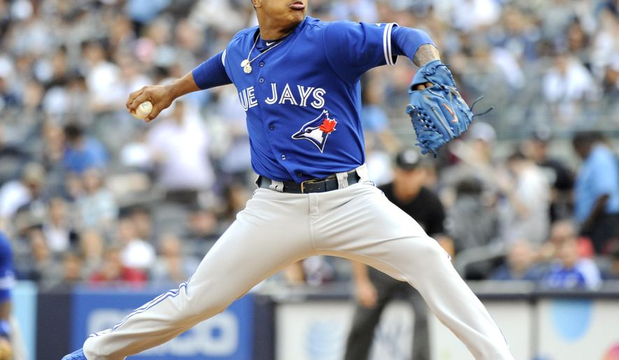 Toronto Blue Jays pitcher Marcus Stroman delivers the ball to the New York Yankees during the first inning of a baseball game Saturday, Sept. 20, 2014, at Yankee Stadium in New York. (AP Photo/Bill Kostroun)