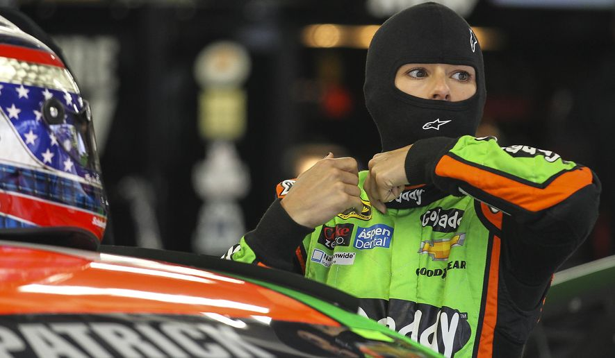 Driver Danica Patrick prepares to get into her car during practice for the NASCAR Sprint Cup auto race at New Hampshire Motor Speedway, Saturday, Sept. 20, 2014, in Loudon, N.H. (AP Photo/Cheryl Senter)