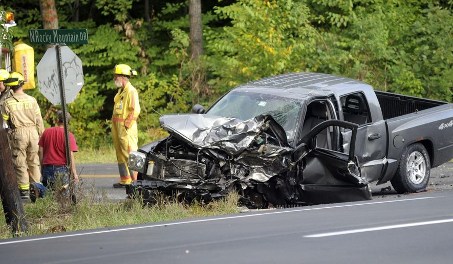 Officers stand near the scene of a fatal car accident on Route 115 in Effort, Pa., on Saturday, Sept. 20, 2014. Four vehicles were reportedly involved. Authorities haven't released any names or further details. (AP Photo/Pocono Record, Keith R. Stevenson)