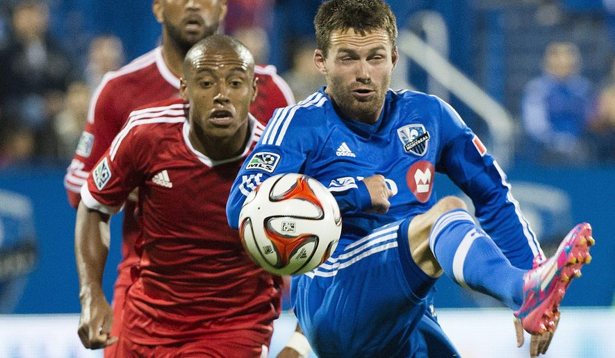 Montreal Impact's Jack McInerney, right, and San Jose Earthquakes' Pablo Pintos battle for the ball during the second half of a soccer game, Saturday, Sept. 20, 2014 in Montreal. (AP Photo/The Canadian Press, Graham Hughes)