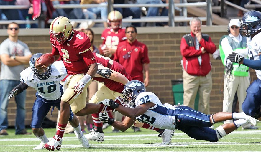 Boston College quarterback Tyler Murpy (2) breaks away from Maine's Rany Samuels (32) to start a touchdown run in the first quarter of an NCAA college football game at Alumni Stadium, Saturday, Sept. 20, 2014, in Boston. (AP Photo/The Boston Herald,  John Wilcox)  BOSTON GLOBE OUT; METRO BOSTON OUT; MAGS OUT; ONLINE OUT