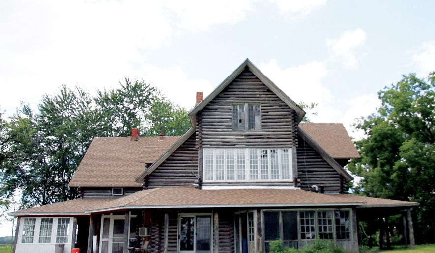 """This Sept. 15, 2014 photo shows the """"Hog Ranch,"""" a historic home with a colorful history straddling the Pottawattamie-Mills county line in Iowa, which is for sale. (AP Photo/The Daily Nonpareil, John Schreier)"""