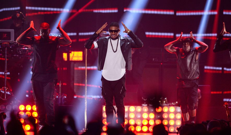 Usher performs at the iHeartRadio Music Festival at the MGM Grand Garden Arena on Sept. 19, 2014 in Las Vegas, Nevada. (Photo by Al Powers/Powers Imagery/Invision/AP)
