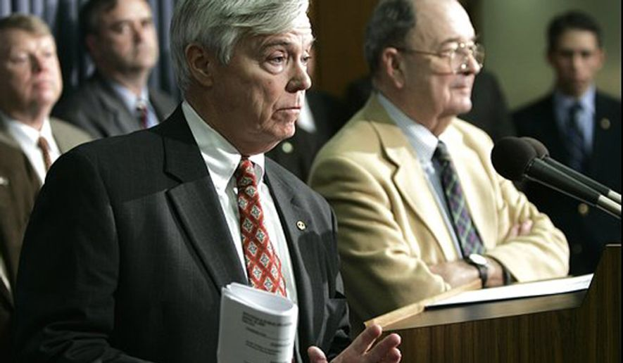 Former Virginia House Speaker William J. Howell, R-Stafford, left, and former Appropriations Committee Chairman Vincent F. Callahan Jr., R-Fairfax, discuss automobile taxes in 2005. (Associated Press) ** FILE **