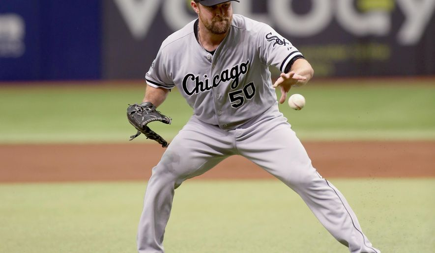 Chicago White Sox starting pitcher John Danks (50) fields an infield ball off of the bat of Tampa Bay Rays second baseman Ben Zobrist (18) during the first inning of a baseball game Sunday, Sept. 21, 2014 in St. Petersburg, Fla.  (AP Photo/Reinhold Matay)
