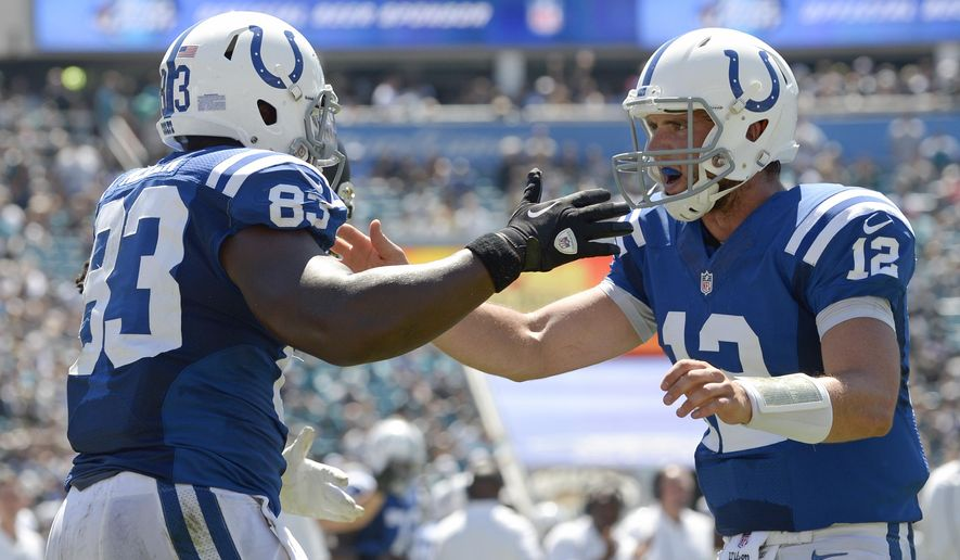 Indianapolis Colts quarterback Andrew Luck (12) congratulates tight end Dwayne Allen (83) after Allen caught a pass for a touchdown during the first half of an NFL football game against the Jacksonville Jaguars in Jacksonville, Fla., Sunday, Sept. 21, 2014. (AP Photo/Phelan M. Ebenhack)