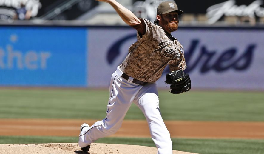 San Diego Padres starting pitcher Ian Kennedy throws against the San Francisco Giants during the first inning of a baseball game Sunday, Sept. 21, 2014, in San Diego. (AP Photo/Don Boomer)