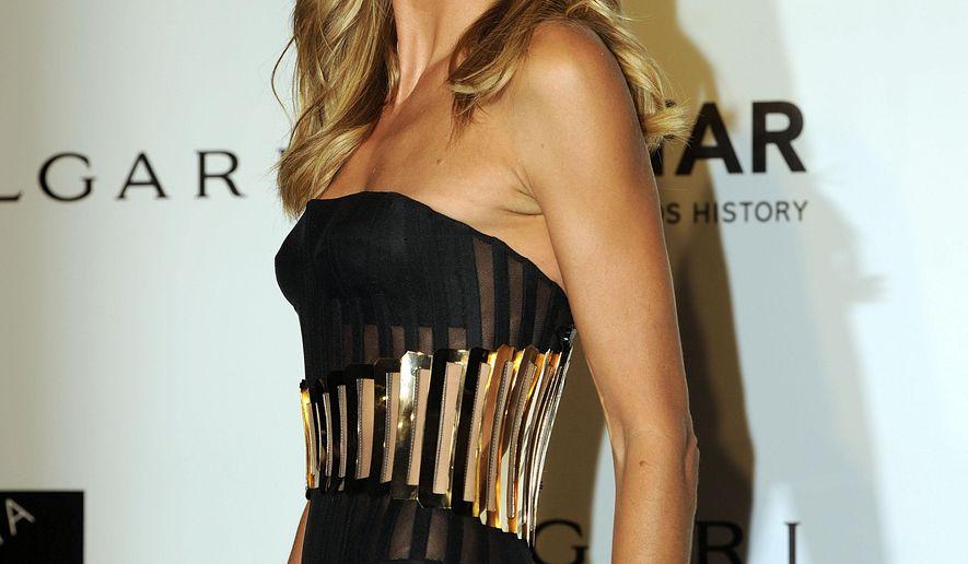Heidi Klum arrives for the amfAR charity dinner during the fashion week in Milan, Italy, Saturday, Sept. 20, 2014. (AP Photo/Giuseppe Aresu)