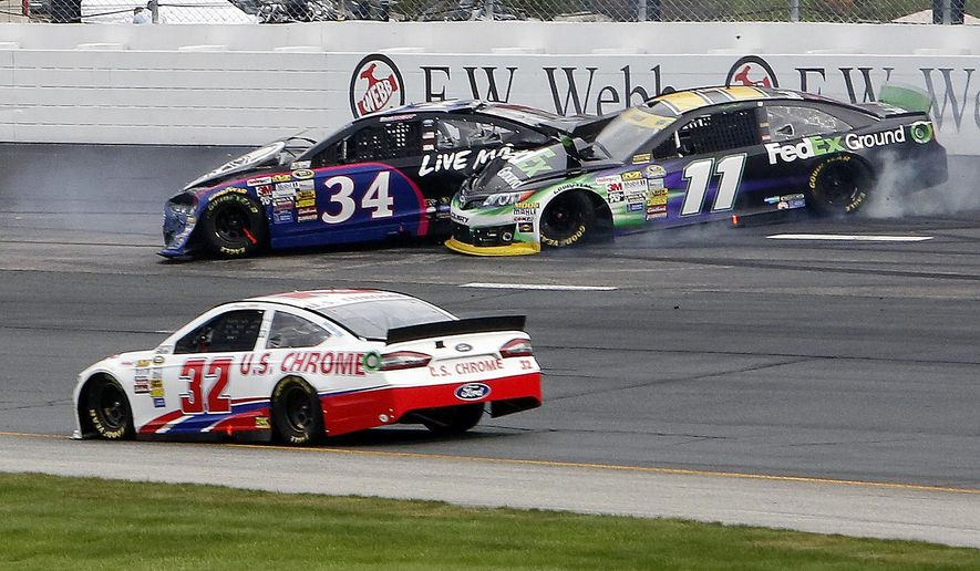 Denny Hamlin (11) slides into David Ragan (34) as he hits the wall as Timmy Hill (32) drives underneath during the NASCAR Sprint Cup Series Sylvania 300 at New Hampshire Motor Speedway Sunday Sept. 21, 2014 in Loudon, N.H. Joey Logano wenty on to win the race. (AP Photo/Jim Cole)