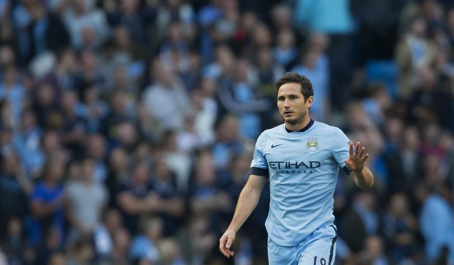 CAPTION CORRECTS THE TEAM - Manchester City's Frank Lampard reacts after scoring against Chelsea during their English Premier League soccer match at the Etihad Stadium, Manchester, England, Sunday Sept. 21, 2014. (AP Photo/Jon Super)