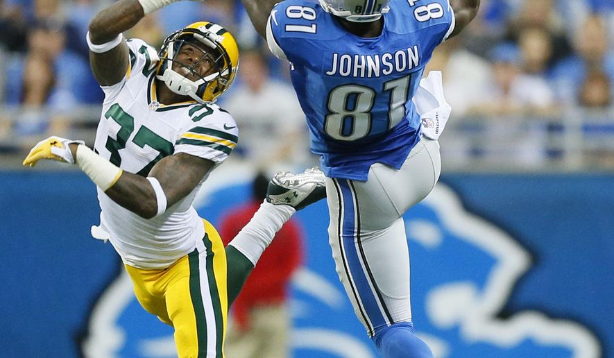 Detroit Lions wide receiver Calvin Johnson (81), defended by Green Bay Packers cornerback Sam Shields (37) makes a catch during the first half of an NFL football game in Detroit, Sunday, Sept. 21, 2014. (AP Photo/Rick Osentoski)