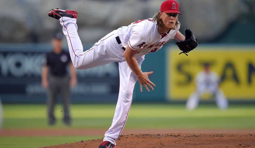 Los Angeles Angels starting pitcher Jered Weaver throws to the plate during the first inning of a baseball game against the Texas Rangers, Saturday, Sept. 20, 2014, in Anaheim, Calif. (AP Photo/Mark J. Terrill)