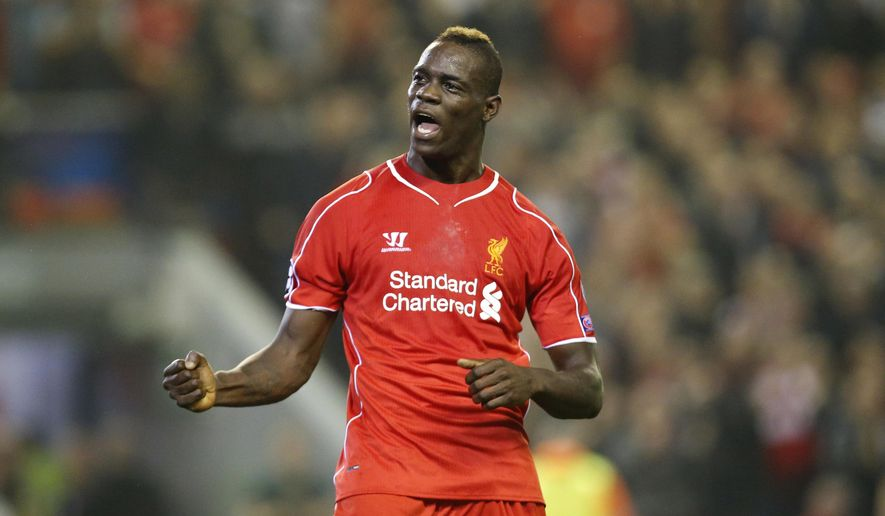 Liverpool's Mario Balotelli celebrates after scoring against Ludogorets during the Champions League Group B soccer match between Liverpool and Ludogorets at Anfield Stadium in Liverpool, England, Tuesday, Sept. 16, 2014. (AP Photo/Jon Super)
