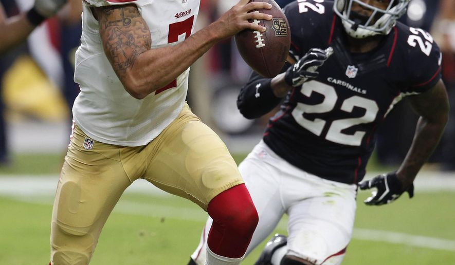 San Francisco 49ers quarterback Colin Kaepernick (7) is pursued by Arizona Cardinals free safety Tony Jefferson (22) during the second half of an NFL football game Sunday, Sept. 21, 2014, in Glendale, Ariz. (AP Photo/Ross D. Franklin)