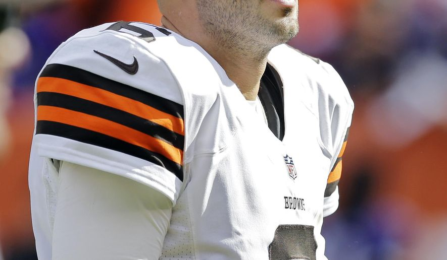 Cleveland Browns quarterback Brian Hoyer walks off the field after a 23-21 loss to the Baltimore Ravens in an NFL football game Sunday, Sept. 21, 2014, in Cleveland. (AP Photo/Tony Dejak)