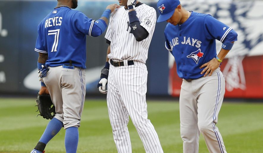 Toronto Blue Jays shortstop Jose Reyes, left, and second baseman Ryan Goins, right, talk with New York Yankees' Derek Jeter during a pitching change in the seventh inning of the baseball game at Yankee Stadium, Sunday, Sept. 21, 2014 in New York. (AP Photo/Seth Wenig)