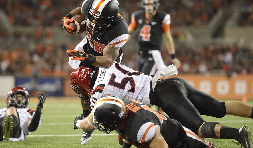 Oregon State tailback Terron Ward (28) scores a touchdown against San Diego State during the second quarter of an NCAA college football game in Corvallis, Ore., Saturday, Sept. 20, 2014. (AP Photo/Troy Wayrynen)