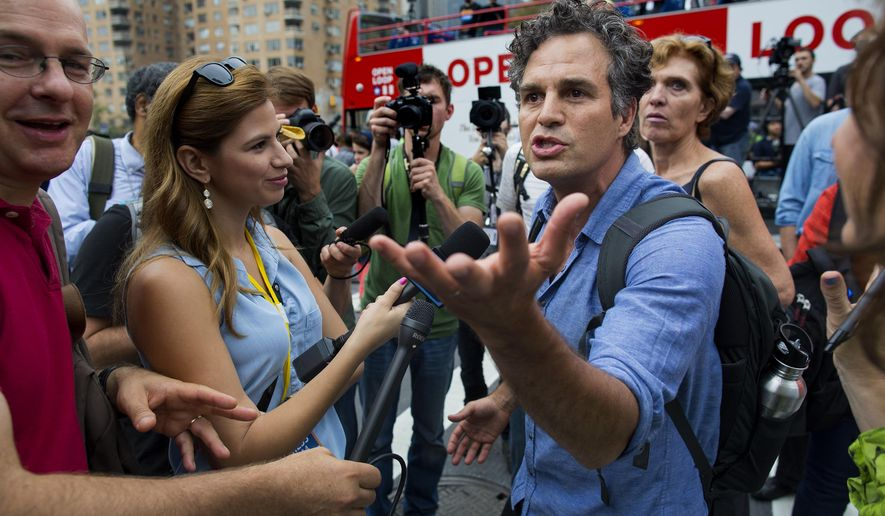 Actor and activist Mark Ruffalo takes questions before the start of the People's Climate March in New York Sunday, Sept. 21, 2014. Thousands of people from across the nation are expected to participate in what's billed as the largest march ever on global warming. (AP Photo/Craig Ruttle) ** FILE **