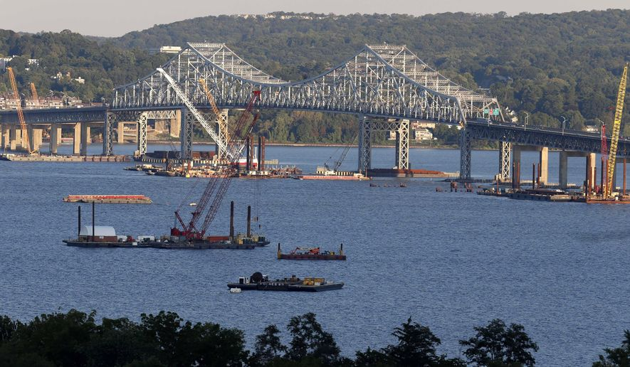 In this Sept. 18, 2014 photo, construction equipment is positioned near the Tappan Zee Bridge as seen from Nyack, N.Y. With a price tag of $3.9B, the new Tappan Zee Bridge is one of the most expensive public works projects in U.S. history, yet New York Gov. Andrew Cuomo hasn't said how high tolls will have to be to pay for it. (AP Photo/Seth Wenig)