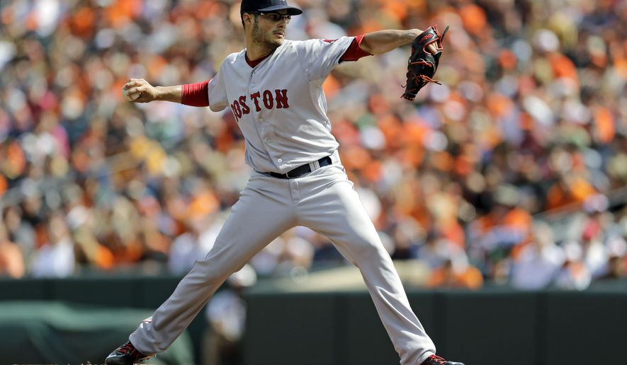 Boston Red Sox starting pitcher Joe Kelly throws to the Baltimore Orioles in the first inning of a baseball game, Sunday, Sept. 21, 2014, in Baltimore. (AP Photo/Patrick Semansky)
