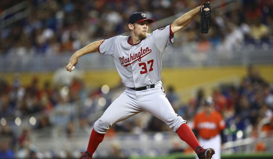 Washington Nationals starter Stephen Strasburg pitches to the Miami Marlins during during the first inning of a baseball game in Miami, Sunday, Sept. 21, 2014. (AP Photo/J Pat Carter)