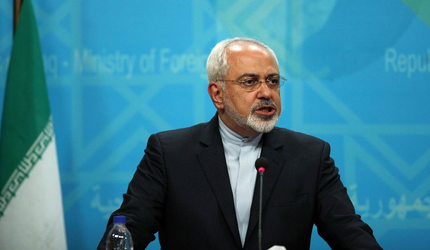 FILE - In this Sunday, Aug. 24, 2014 file photo, Iranian Foreign Minister Mohammad Javad Zarif speaks during a joint news conference with his Iraqi counterpart in Baghdad.  With little more than two months to deadline, Iran and six world powers on Friday, Sept. 19, 2014,  launched a fresh effort at narrowing stubborn differences on what nuclear concessions Tehran must agree to in exchange for full sanctions relief.  (AP Photo/Ahmed Saad, Pool)