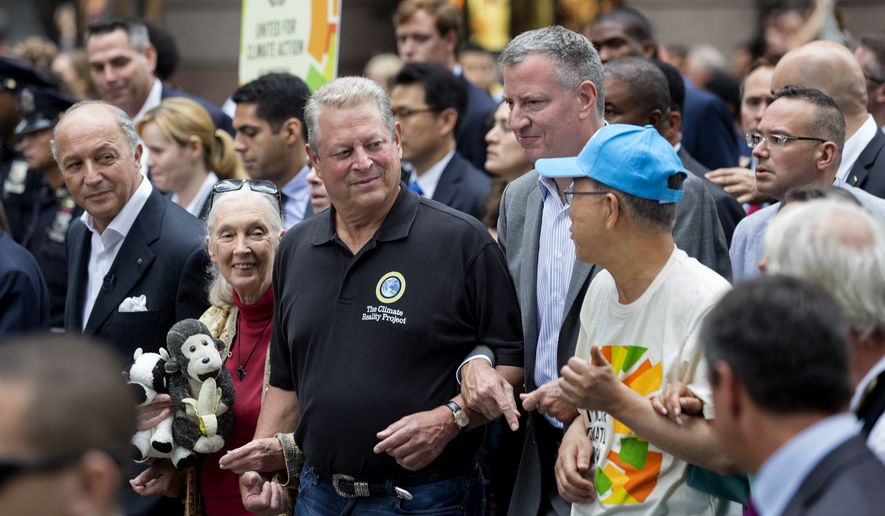 From left, French Foreign Minister Laurent Fabius, primatologist Jane Goodall, former U.S. Vice President Al Gore, New York Mayor Bill de Blasio, and  U.N. Secretary General Ban Ki-moon participate in the People's Climate March in New York Sunday, Sept. 21, 2014. Thousands of demonstrators filled the streets of Manhattan on Sunday, accompanied by drumbeats, wearing costumes and carrying signs as they urged policy makers to take global action on climate change.  (AP Photo/Craig Ruttle)