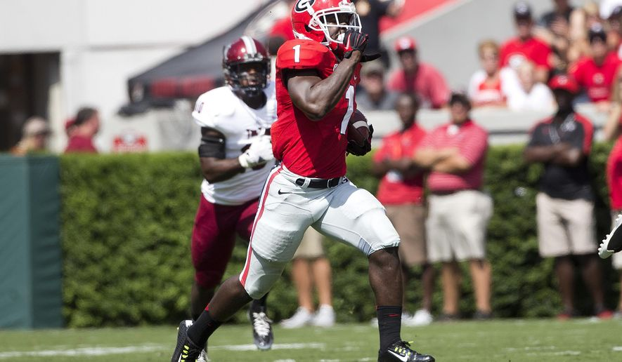 Georgia running back Sony Michel (1) runs for a first down in the in the first half of an NCAA college football game against Troy, Saturday, Sept. 20, 2014, in Athens, Ga. Georgia won 66-0. (AP Photo/John Bazemore)