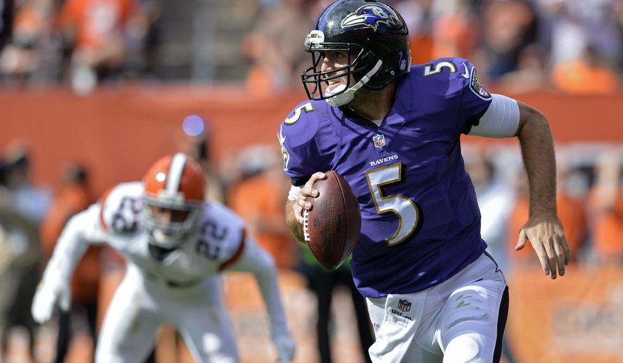 Baltimore Ravens quarterback Joe Flacco (5) runs against the Cleveland Browns in the fourth quarter of an NFL football game Sunday, Sept. 21, 2014, in Cleveland. (AP Photo/David Richard)