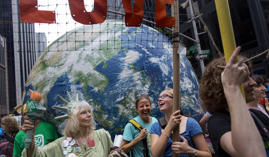 Marchers with a group called Backbonecampaign.org from Vashon, Washington, march along 6th Ave. during the People's Climate March in New York Sunday, Sept. 21, 2014. (AP Photo/Craig Ruttle)