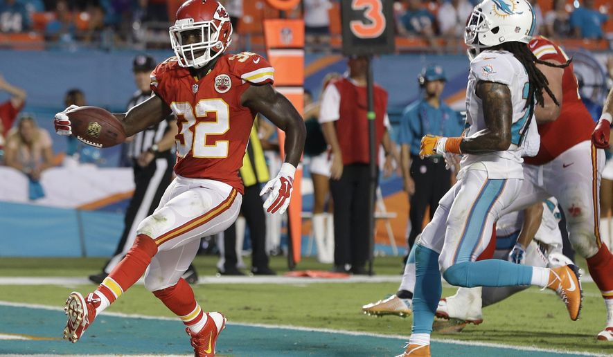 Kansas City Chiefs running back Cyrus Gray (32) scores a touchdown past Miami Dolphins cornerback Will Davis, right, during the second half of an NFL football game, Sunday, Sept. 21, 2014, in Miami Gardens, Fla. The Chiefs defeated the Dolphins 34-15. (AP Photo/Lynne Sladky)