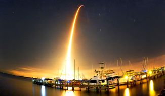 A SpaceX Falcon 9 rocket lights up the sky during liftoff at 1:52.03 a.m. Sunday morning Sept. 21, 2014 for the resupply mission to the International Space Station photo taken at the Whitley Marina Cocoa. (AP Photo/Florida Today, Craig Rubadoux)