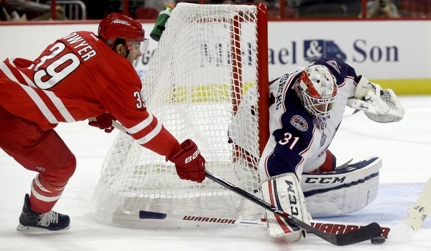 Carolina Hurricanes' Patrick Dwyer (39) is blocked by Columbus Blue Jackets' Anton Forsberg (31), of Sweden, during the first period of an NHL preseason hockey game in Raleigh, N.C., Sunday, Sept. 21, 2014. (AP Photo/Gerry Broome)