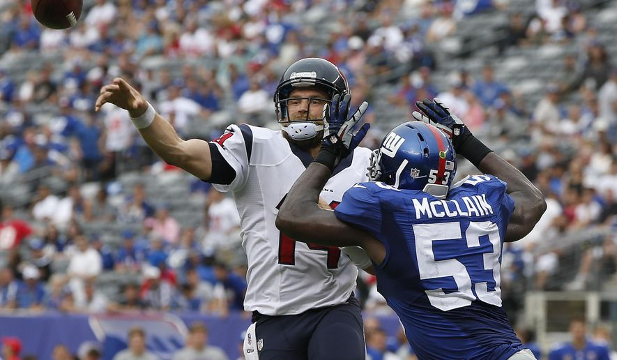 Houston Texans quarterback Ryan Fitzpatrick (14) throws under pressure from New York Giants outside linebacker Jameel McClain (53) in the fourth quarter of an NFL football game, Sunday, Sept. 21, 2014, in East Rutherford, N.J. (AP Photo/Kathy Willens)