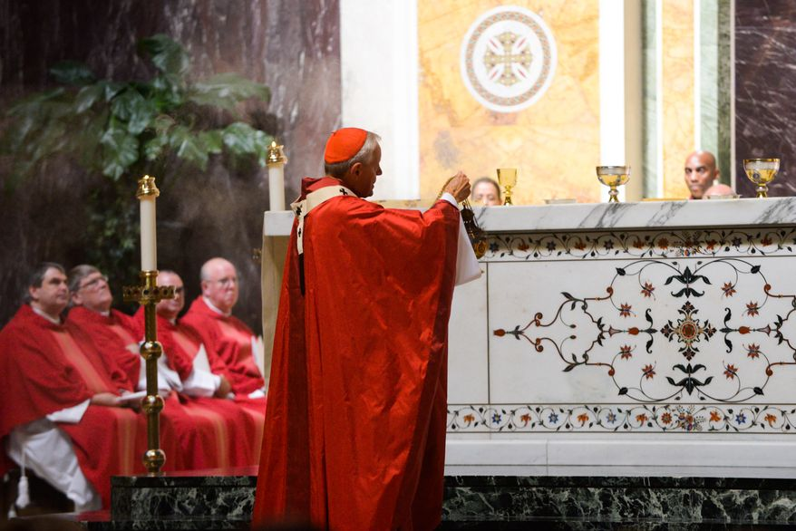 Donald Cardinal Wuerl, Archbishop of Washington, walks the altar before communion during Mass of Thanksgiving in Celebration of the 75th Anniversary of the Archdiocese of Washington at the Cathedral of Saint Matthew The Apostle in Northwest on Sunday, September 21, 2014. Khalid Naji-Allah/ Special to The Washington Times