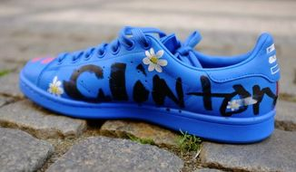 Pharrell Williams unveiled a new line of Adidas tennis sneakers over the weekend, customizing his own pair to carry an important message for former Secretary of State Hillary Clinton. (Complex/Adidas Originals)
