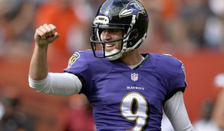 Baltimore Ravens kicker Justin Tucker celebrates his game-winning field goal as time expires in a 23-21 win over the Cleveland Browns in an NFL football game Sunday, Sept. 21, 2014, in Cleveland. (AP Photo/David Richard)