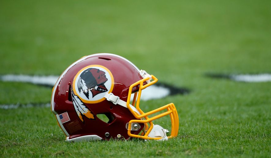 A Washington Redskins helmet sits on the field during warm ups before an NFL football game against the Philadelphia Eagles, Sunday, Sept. 21, 2014, in Philadelphia. (AP Photo/Matt Rourke)