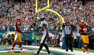 Philadelphia Eagles' Jeremy Maclin reacts after scoring a touchdown during the second half of an NFL football game against the Washington Redskins, Sunday, Sept. 21, 2014, in Philadelphia. (AP Photo/Matt Rourke)