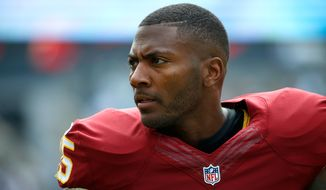 Washington Redskins' Ryan Clark walks the sidelines during the first half of an NFL football game against the Philadelphia Eagles, Sunday, Sept. 21, 2014, in Philadelphia. (AP Photo/Matt Rourke)