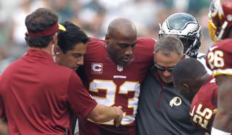 Washington Redskins cornerback DeAngelo Hall (23) is helped off the field during the second half of an NFL football game against the Philadelphia Eagles, Sunday, Sept. 21, 2014, in Philadelphia. (AP Photo/Michael Perez)