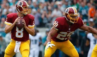 Washington Redskins' Kirk Cousins looks to pass during the first half of an NFL football game against the Philadelphia Eagles, Sunday, Sept. 21, 2014, in Philadelphia. (AP Photo/Matt Rourke)