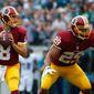 Washington Redskins' Kirk Cousins looks to pass during the first half of an NFL football game against the Philadelphia Eagles, Sunday, Sept. 21, 2014, in Philadelphia. (AP Photo/Matt Rourke)
