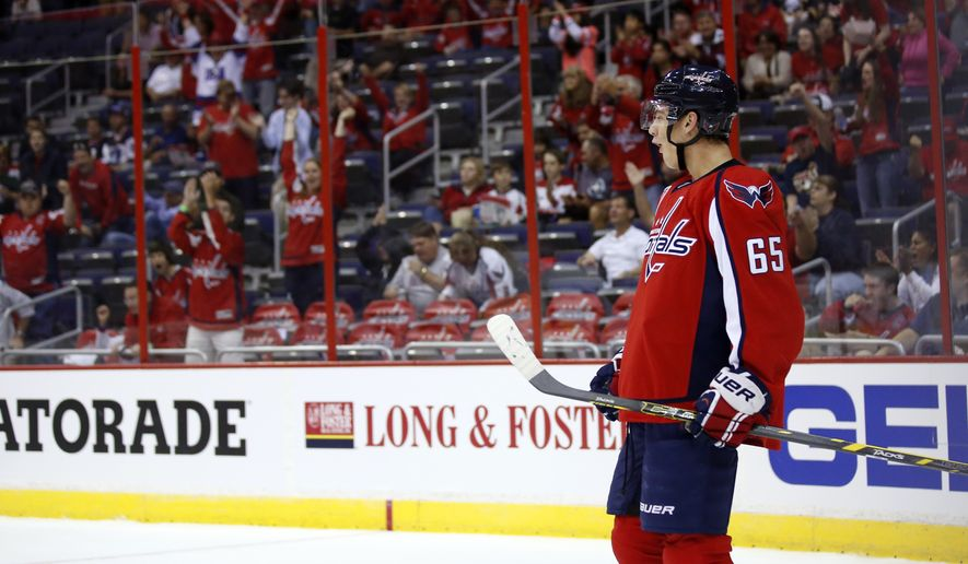 Washington Capitals left wing Andre Burakovsky (65), from Austria, celebrates after his goal in the first period of a preseason NHL hockey game against the Buffalo Sabres, Sunday, Sept. 21, 2014, in Washington. (AP Photo/Alex Brandon)