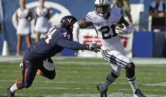 Brigham Young running back Jamaal Williams (21) carries the ball as Virginia linebacker Henry Coley (44) defends in the second half during an NCAA college football game Saturday, Sept. 20, 2014, in Provo, Utah. (AP Photo/Rick Bowmer)