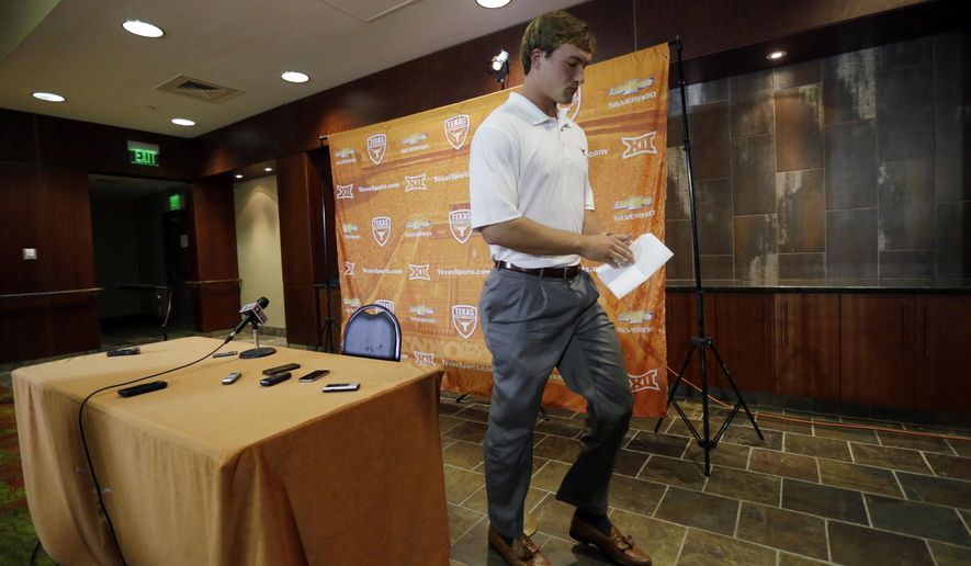 Texas NCAA college football quarterback David Ash leaves a news conference after talking about his decision to give up football after repeated concussions during a news conference, Monday, Sept. 22, 2014, in Austin, Texas. (AP Photo/Eric Gay)