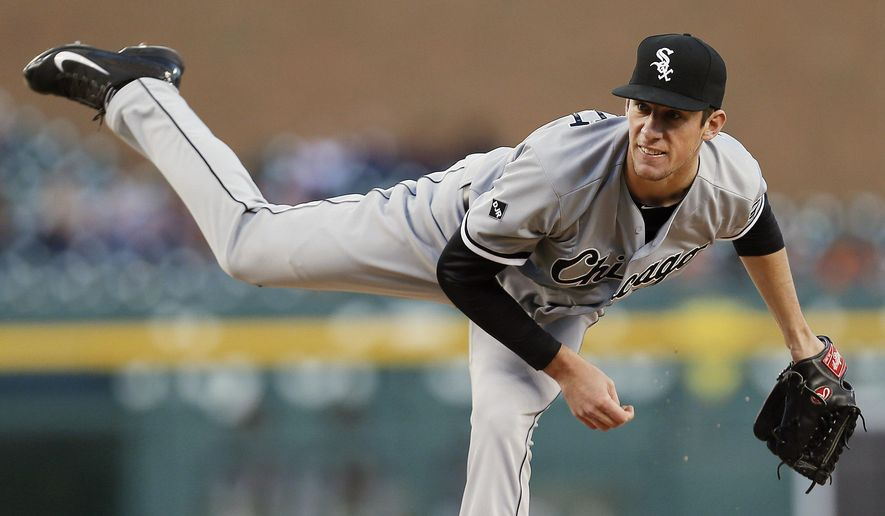 Chicago White Sox pitcher Chris Bassitt throws against the Detroit Tigers in the first inning of a baseball game in Detroit Monday, Sept. 22, 2014. (AP Photo/Paul Sancya)